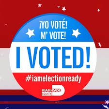 voting sticker that is blue white and red it says i voted in english spanish and creole with the hashtag i am election ready