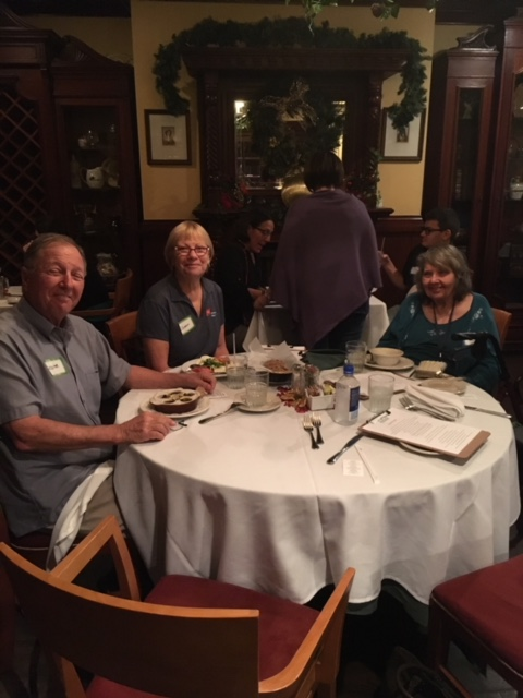 Sharon, Lester, and another guest sitting at a table at the supper social dinner at John Martin's.