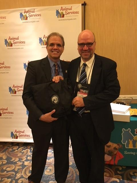 Gregg Morton giving Matthew Dietz the Animal Law Section award in the Puppy Pti