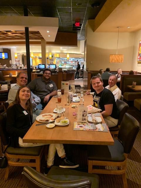 supper social participants eating dinner at california pizza kitchen