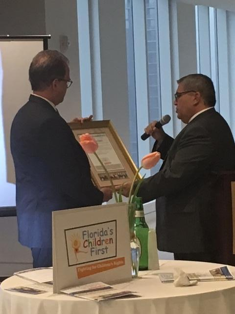 Public Defender Carlos Martinez awarding Matt with the FCF 2017 Honoree award.