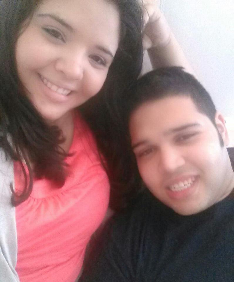 Arnaldo Rios-Soto and his sister Miriam Rios.  Miriam and Arnaldo both have dark hair, miriam is wearing a pink shirt, and arnaldo is wearing a black shirt.