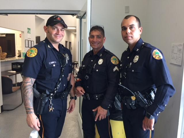 city of miami police officers getting ready to role play with students