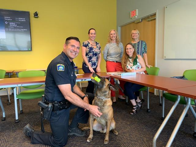 Officer Alex and Roy with the Childrens Trust Team having a meeting about the  k9s for kids project