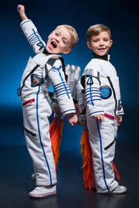 Two boys dressed up as astronauts.