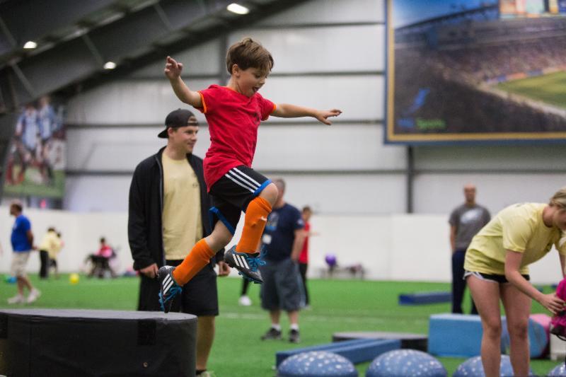 Child in air_ Scoring Goals for Autism