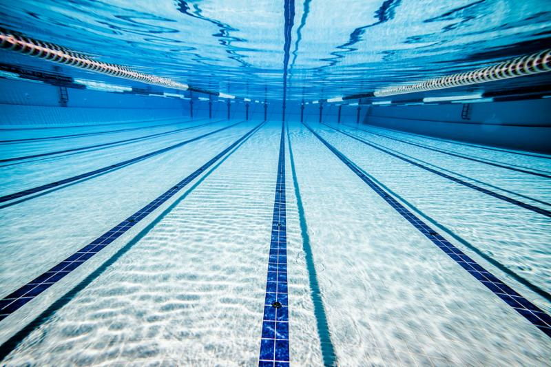 Swimming pool under water background