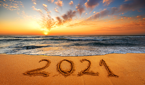 Happy New Year 2021  Written 2021 on the beach. Happy New Year 2021 is coming concept sandy.f
