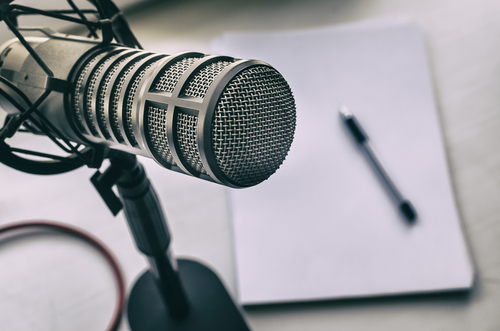 Microphone_ sheets of paper and pen