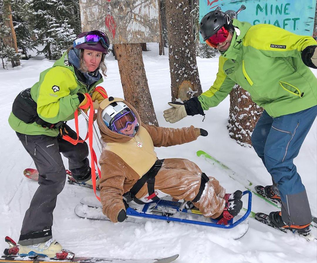 BOEC adaptive ski instructors with a particpant