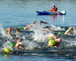 Open water, kayak, volunteer, swimming, swimmer