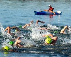 Open water, kayak, volunteer, swimming, swimmer