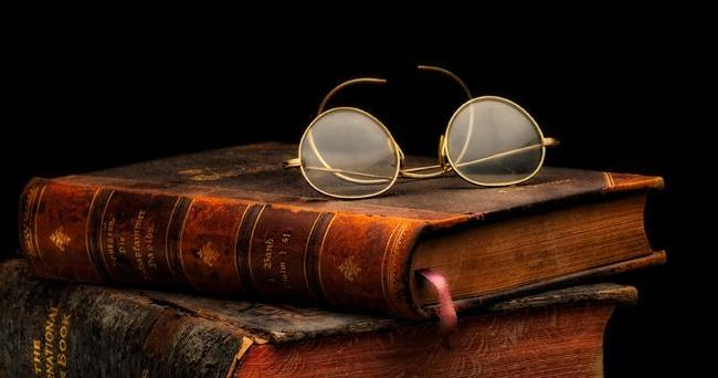 Antique books and glasses