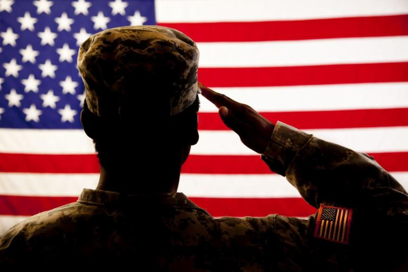 soldier saluting flag