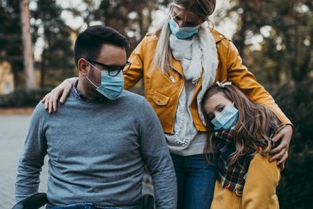 Caucasian family wearing masks