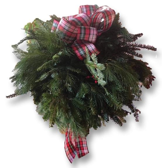 Kissing ball made using pine branches tied with a red plaid ribbon