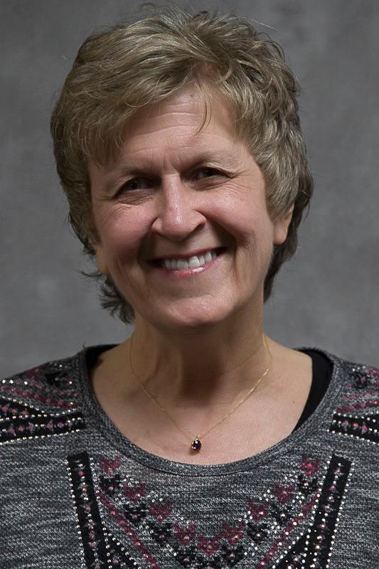 Image of Susan Bashinski's face and shoulders. She is smiling.