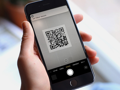 hand holding smartphone with qr code-2.png