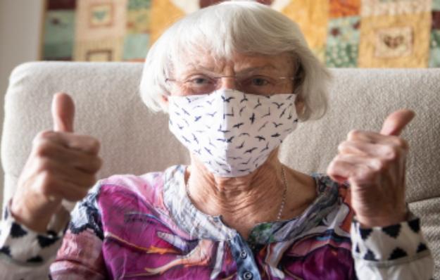 older woman-mask-thumbs up.png