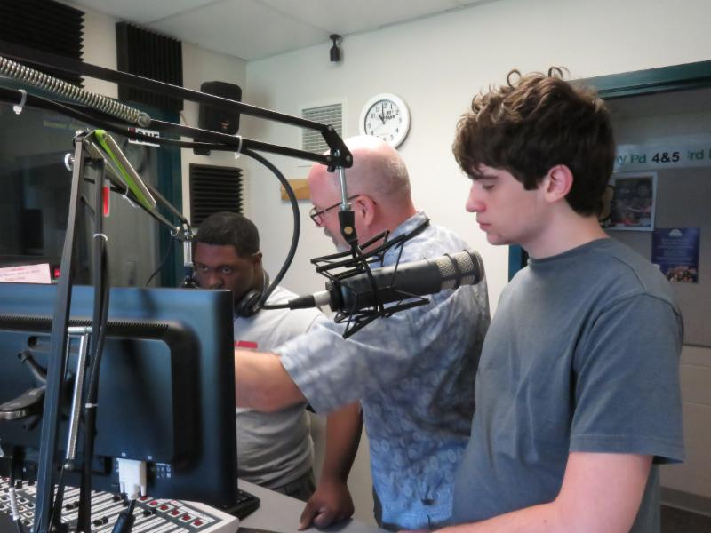 Photo from the WMPH Summer Camp. Students with the instructor in the radio station's broadcast studio.
