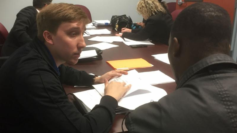 Andrew Duncan, APEX Program Specialist, helping a client at Community Expungement Clinic.