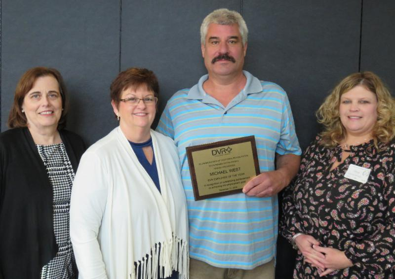 Mike West, Employee of the Year.   Pictured above: Andrea Guest, DVR Director; Deb Post, Retired DVR Vocational Rehabilitation Counselor; Mike West; and Stacey Bragg, DVR Business  Relations Specialist.