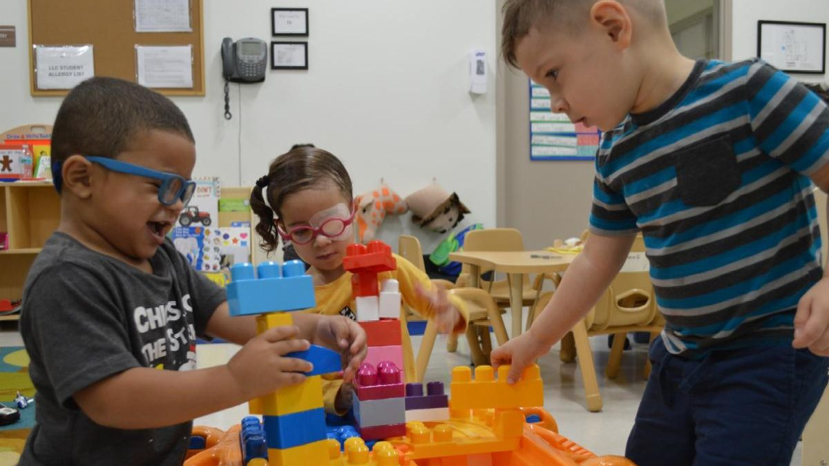 Kids playing with building blocks in a classroom