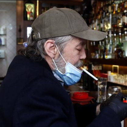 Bosnian Man with Mask and Cigarette