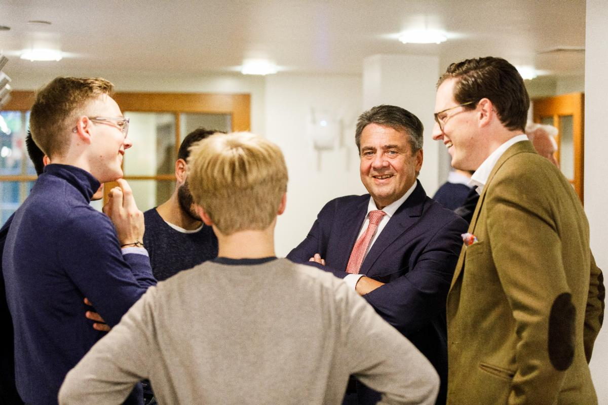 Sigmar Gabriel standing with students