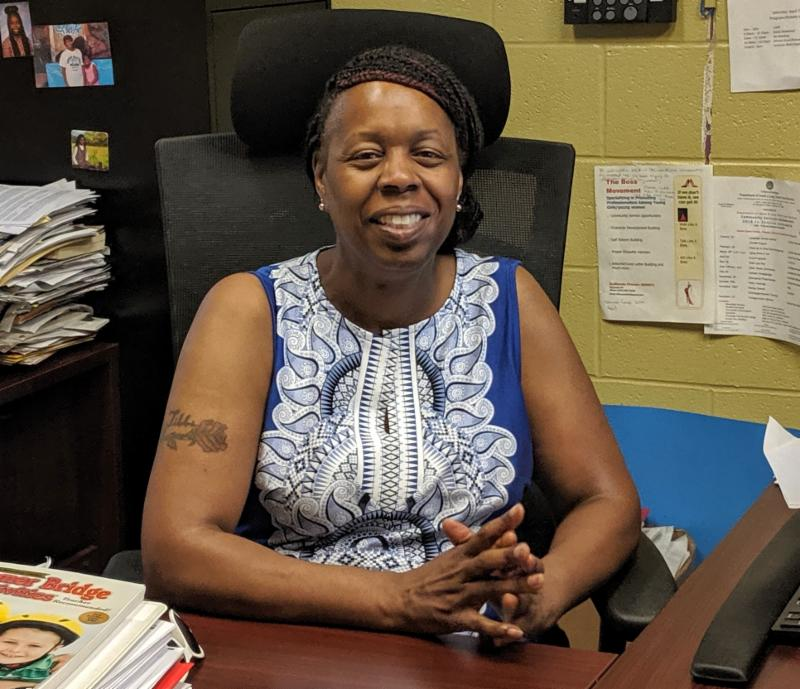 Valerie Hill, the Syracuse Financial Empowerment Center's first customer, sits at her desk at the Southwest Community Center.