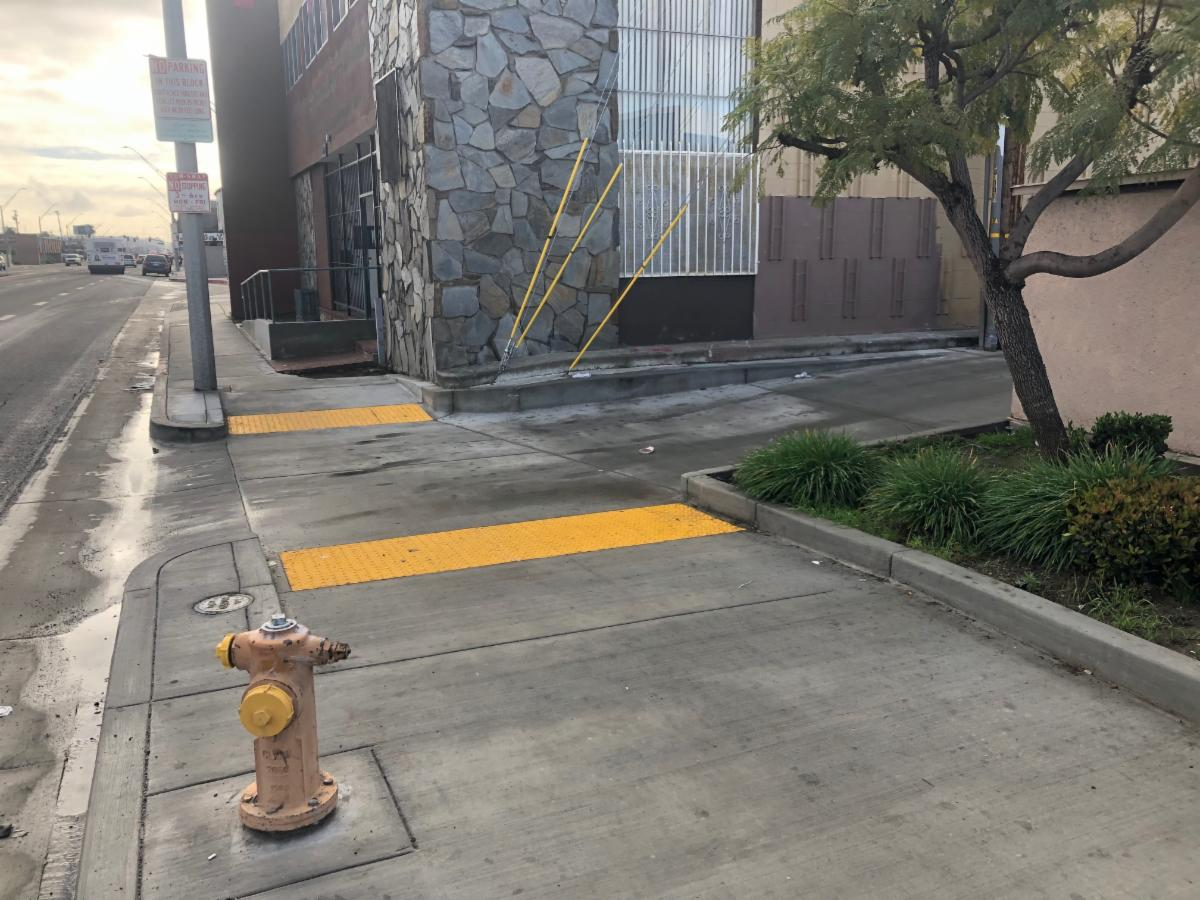 State Route 1 near Long Beach Avenue in Long Beach.  Caltrans upgraded the alley crossing to warn visually impaired pedestrians of potential vehicle traffic.