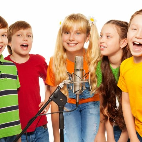 Classmates singing together standing with microphone isolated