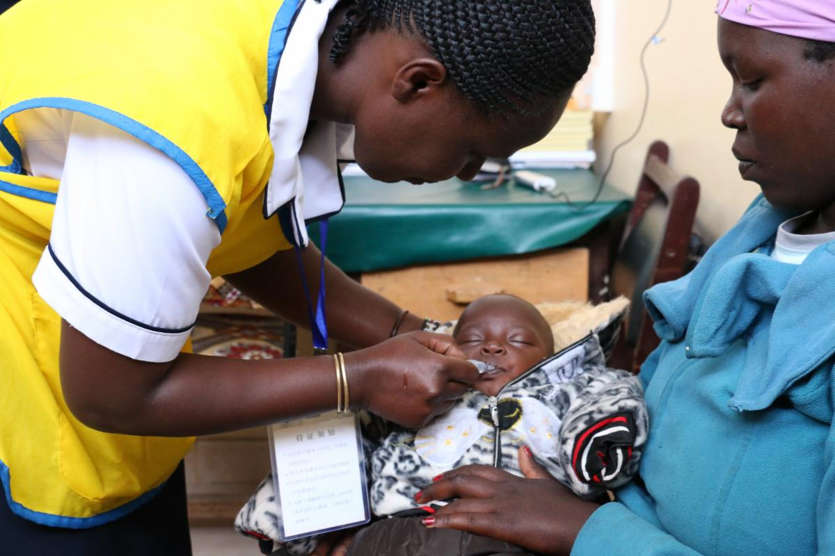 A nurse administers a vaccine at Kapenguria County Referral Hospital in West Pokot, Kenya.