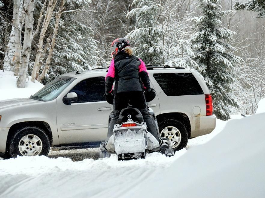 snowmobile stopped for car