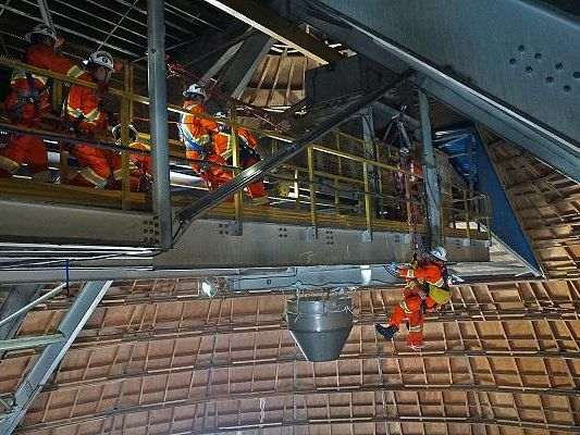 Workers conducting rope rescue exercise