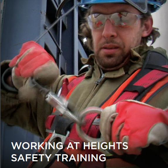 Worker in fall arrest harness