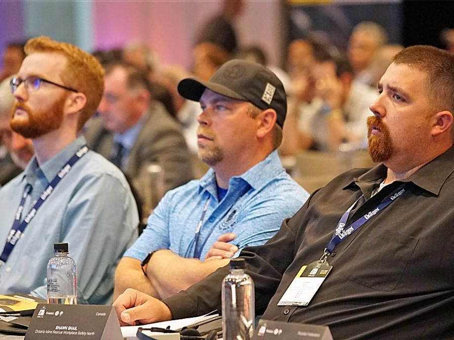 Three workers attend conference