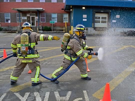 Two workers attending training