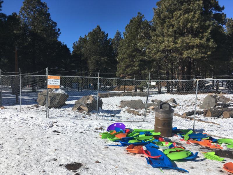 Broken sleds litter Fort Tuthill County Park