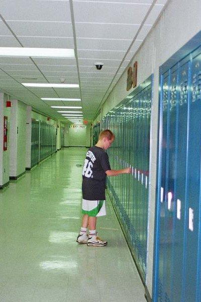 TEMS hall w kid at locker