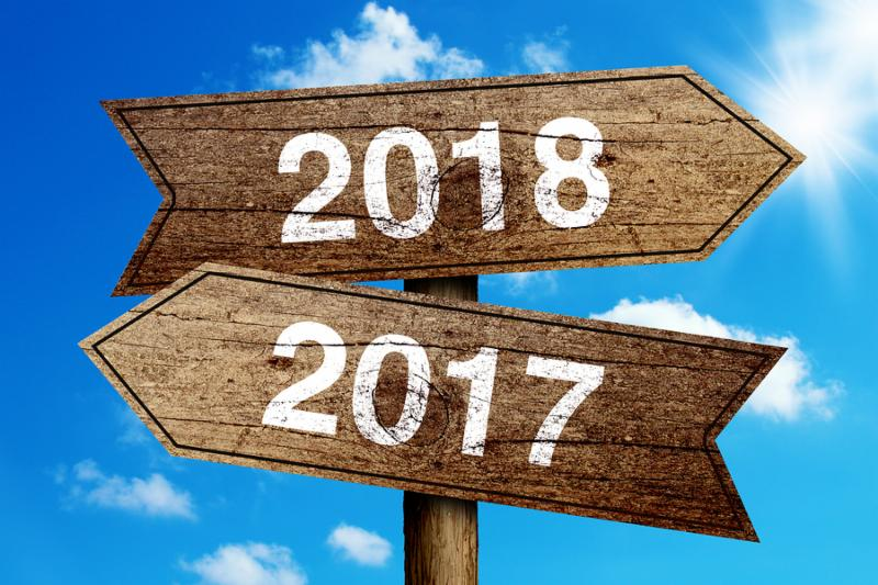 Year 2017 and 2018 road sign with blue sky background.