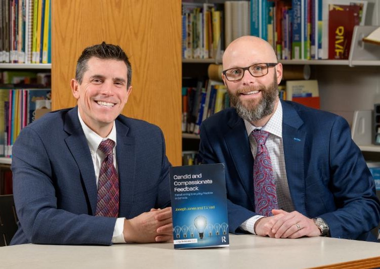 Dr. Jones (left) and TJ Vari with their book