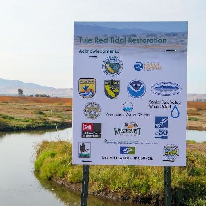 Agency logos at the tule red restoration site in the Sacramento-San Joaquin Delta.