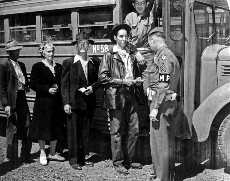 Workers heading on a bus to Los Alamos National Laboratory. Photo courtesy of the Los Alamos History Museum Archives.