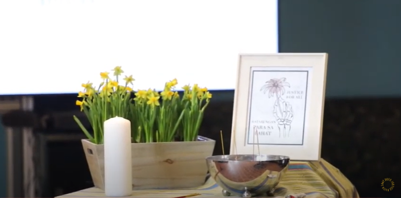 photo from the March 26 vigil - altar table holding candle incense bowl framed painting and planter with daffodils