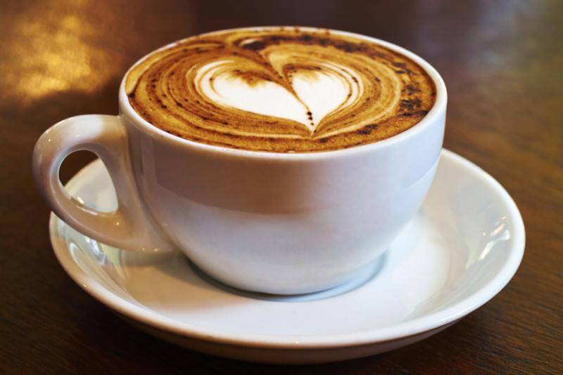 image of a cup of coffee with a heart drawn in the foam