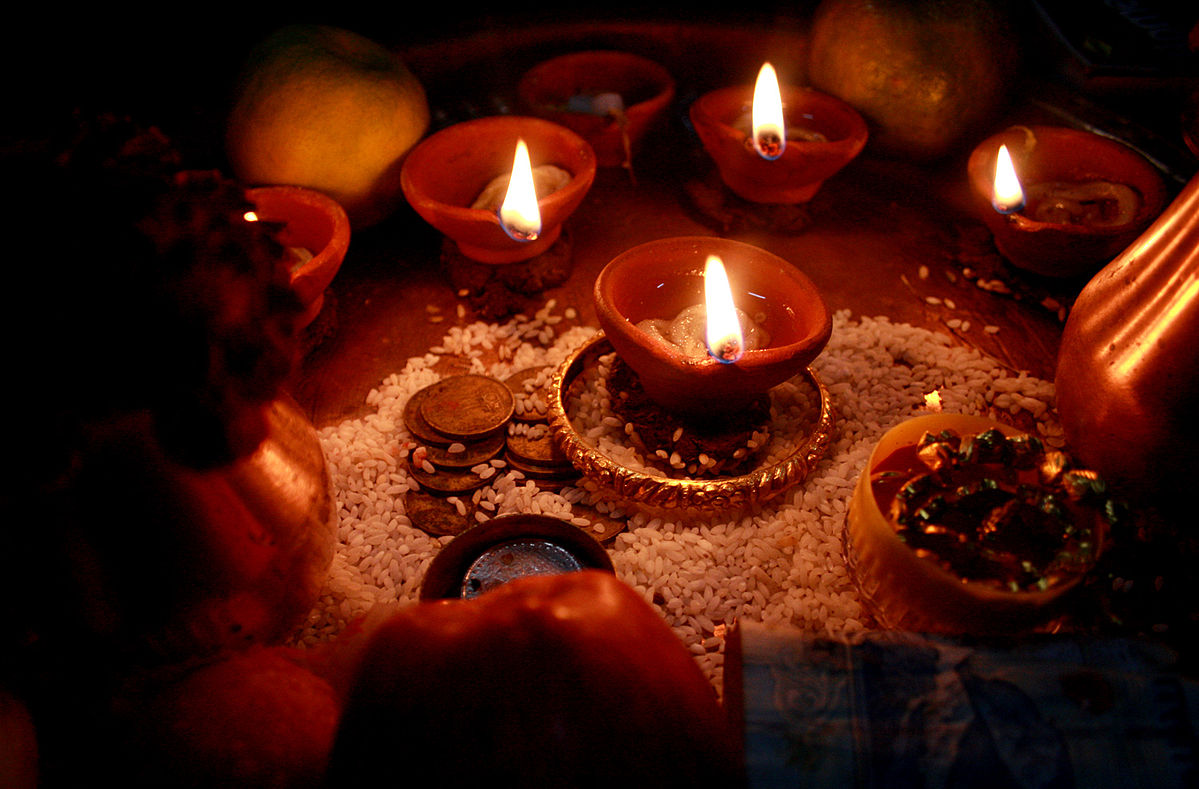 photo of clay lamps lit to celebrate Diwali