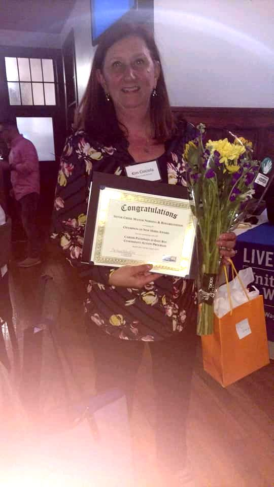 Kimberly Ciociola, Administrator of Silver Creek Manor Nursing and Rehabilitation Center, with her Champion of New Hires citation.