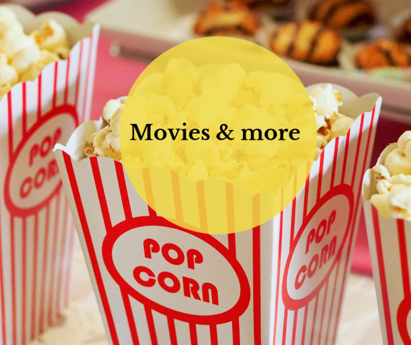 Movie popcorn container yellow circle with words movies and more