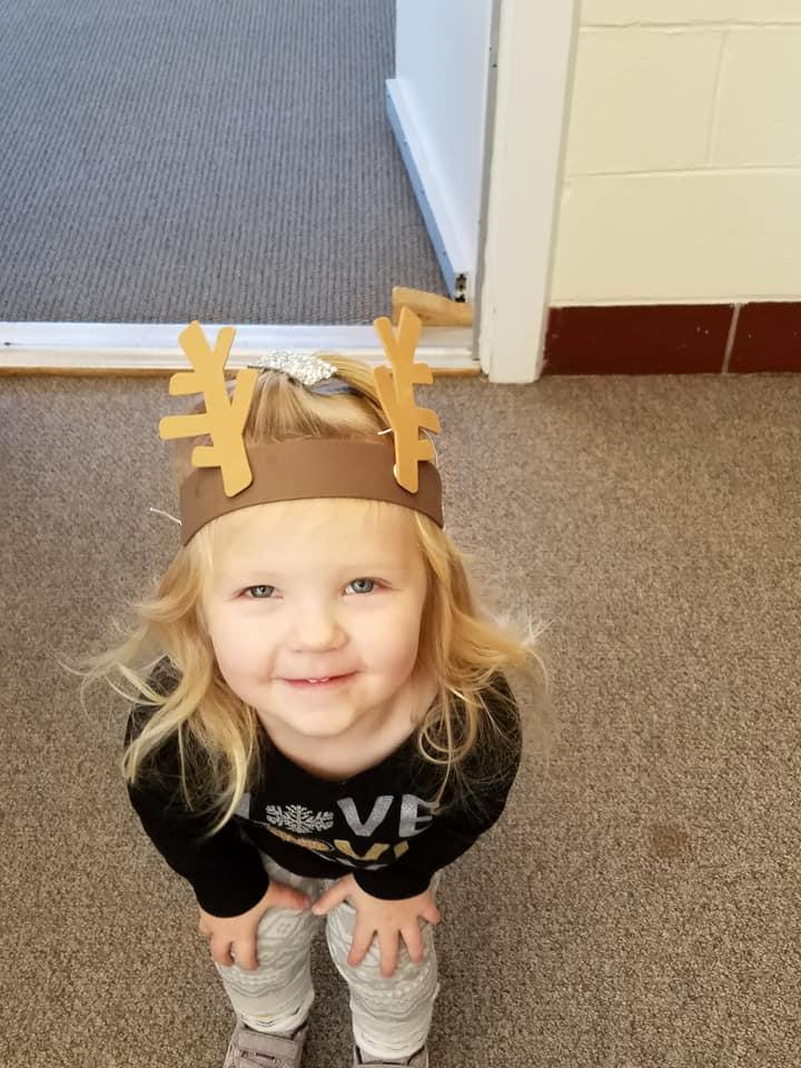 Little girl wearing home made antlers